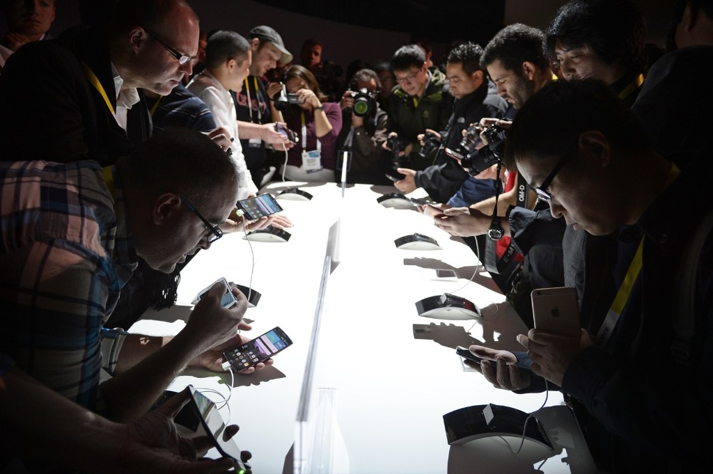 Attendees get their first hands-on look at the new LG G Flex2 smart phone. ROBYN BECK/AFP/Getty Images