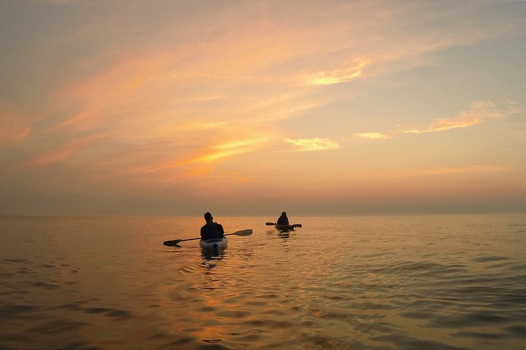 Kayakers paddle on Lake Michigan. AP Photo/Julio Cortez