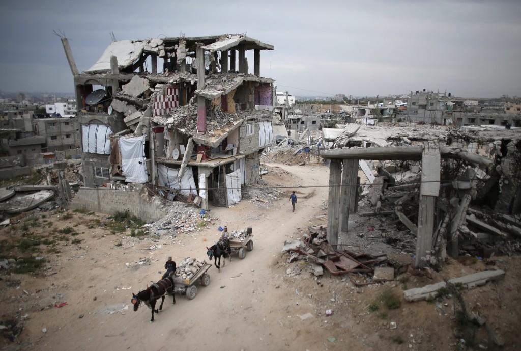 Palestinians ride their donkey-carts in the eastern Gaza City neighbourhood of Shujaiya. THOMAS COEX/AFP/Getty Images