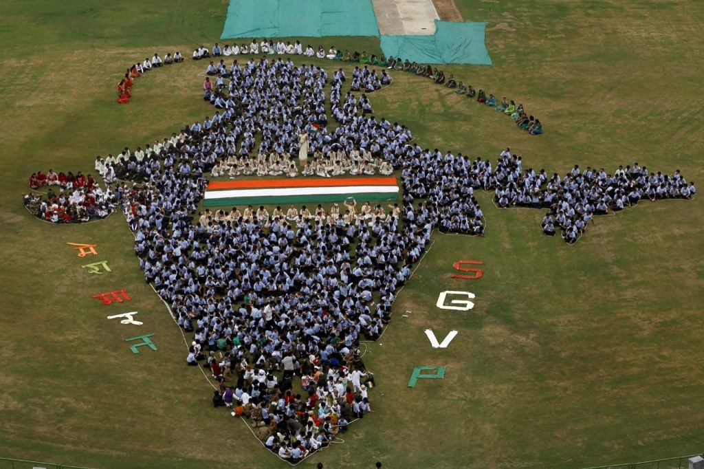 Students make a formation of a map of India inside the school premises during Independence Day celebrations in Ahmedabad, REUTERS/Amit Dave