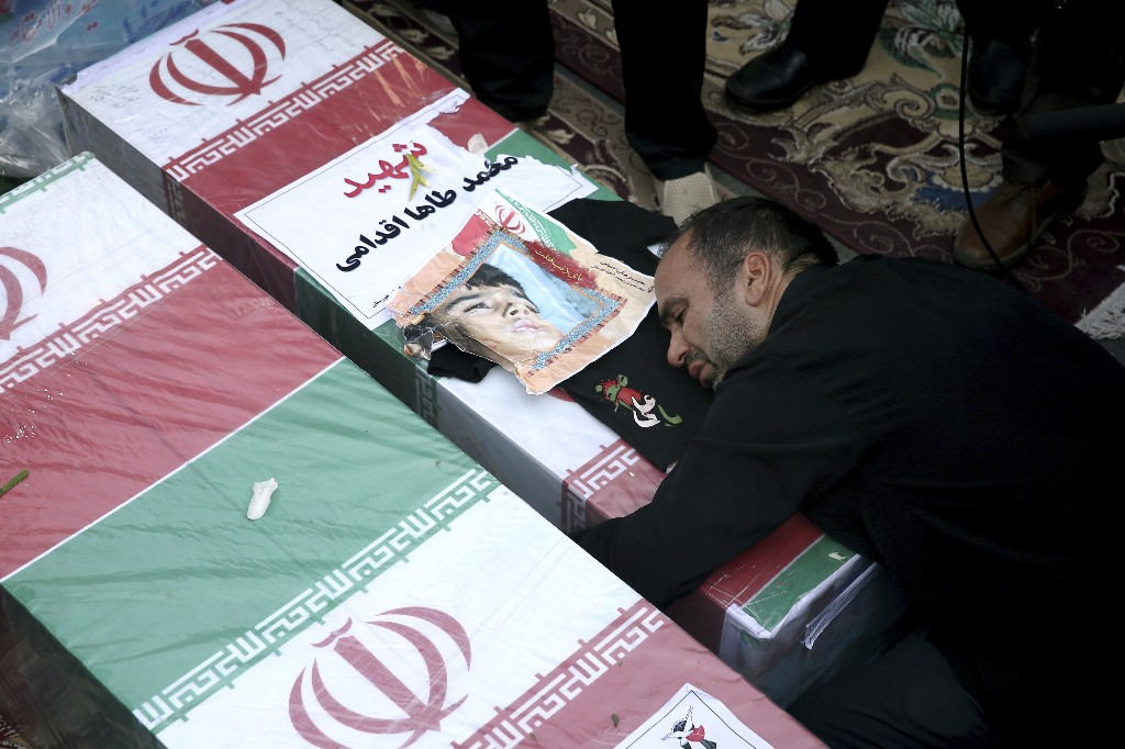 Wails, vows of revenge at Iran funeral after parade attack