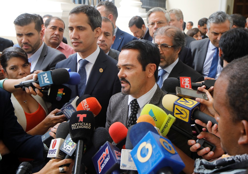 French ambassador to Venezuela Romain Nadal delivers a news conference next to Venezuelan opposition leader Juan Guaido, who many nations have recognized as the country's rightful interim ruler, and accredited diplomatic representatives of the European Union in Caracas, Venezuela February 19, 2019. REUTERS/Marco Bello
