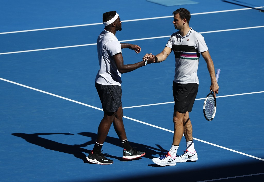 Tennis - Australian Open - Fourth Round - Melbourne Park, Melbourne, Australia, January 20, 2019. Frances Tiafoe of the U.S. and Grigor Dimitrov greet each other after the match. REUTERS/Edgar Su