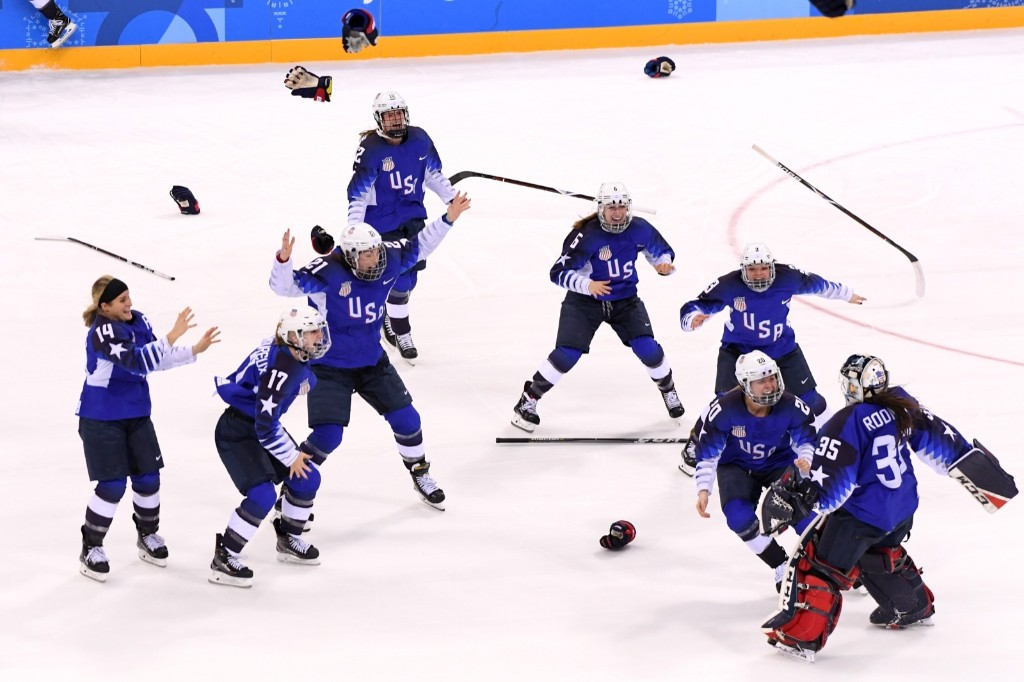 The U.S. celebrates after defeating Canada in a shootout to win the women's gold medal in hockey. Harry How/Getty Images