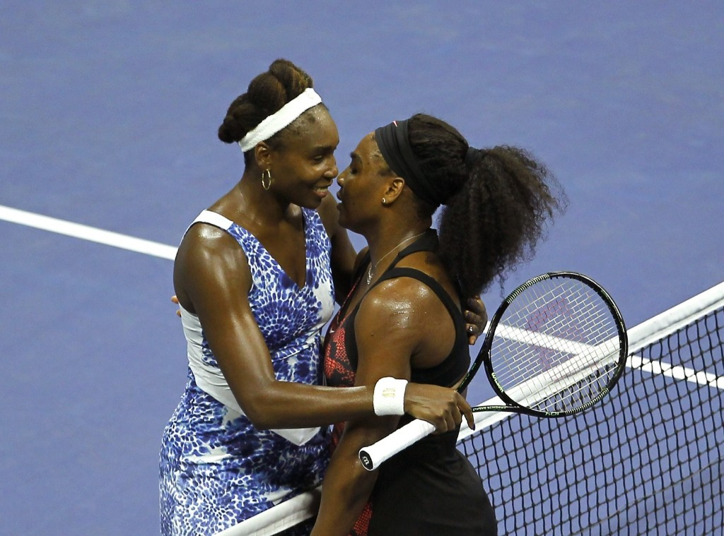 Serena Williams of the U.S. embraces her sister Venus Williams at the net after defeating her in their match at the U.S. Open tennis tournament in New York, Tuesday. Gary Hershorn/Corbis