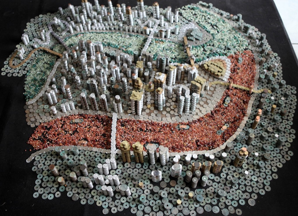 A city model of Chongqing constructed out of 50,000 coins. ChinaFotoPress via Getty Images