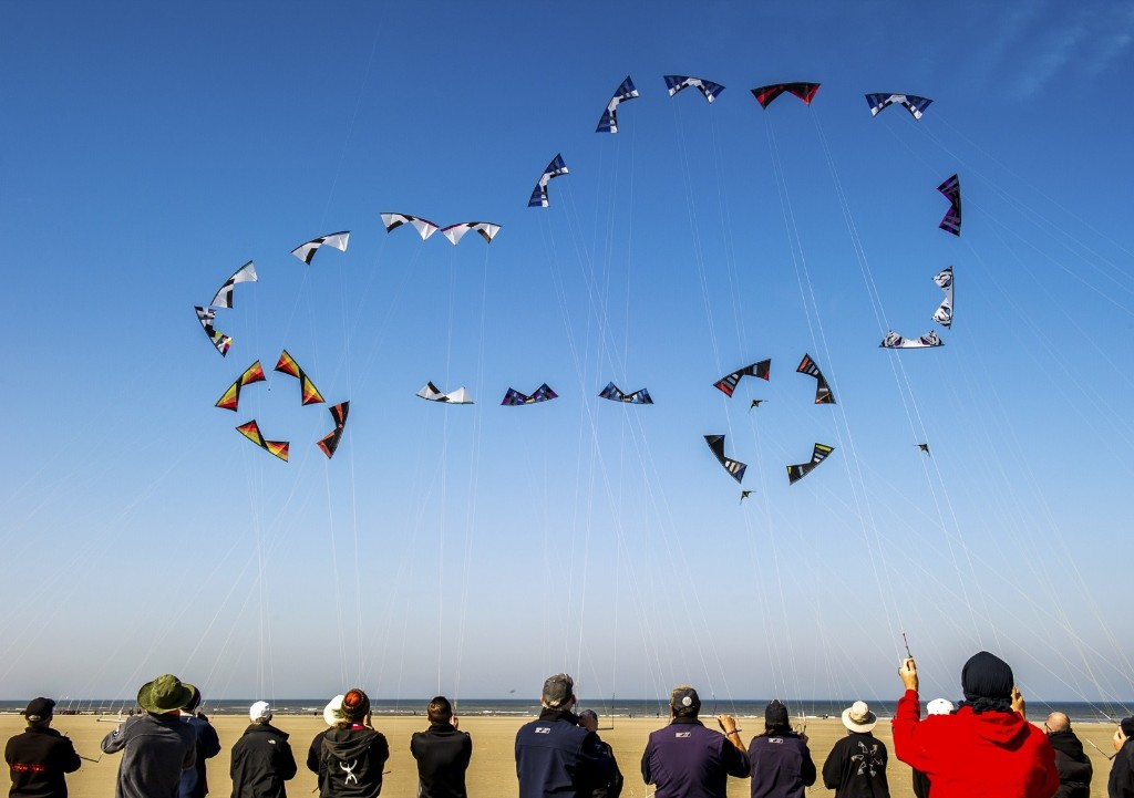 "People fly kites to form the shape of a car in Berck, northern France, during the 29th ""Rencontres Internationales de Cerfs Volants"" (International Kite Meeting). PHILIPPE HUGUEN/AFP/Getty Images"