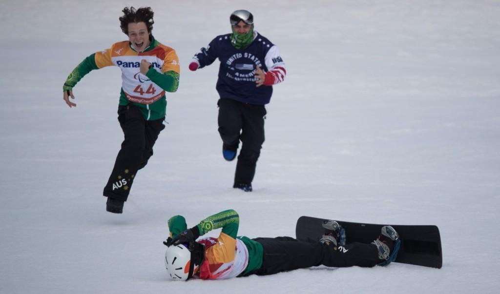 Simon Patmore of Australia lies on the snow as he celebrates winning the Men's Snowboard Cross Final SB-UL at the Jeongseon Alpine Centre. Simon Bruty for OIS/IOC
