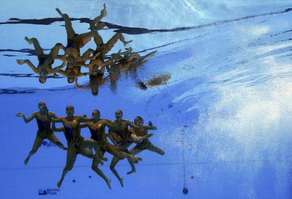 Team Switzerland competes in the women's synchronized swimming prelims. REUTERS/Stefan Wermuth