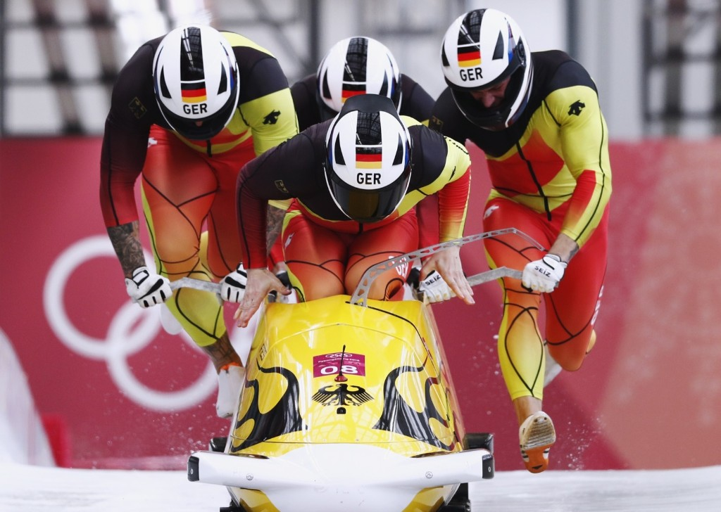 Nico Walther, Kevin Kuske, Alexander Roediger and Eric Franke of Germany start in men's 4-man bobsleigh. REUTERS/Edgar Su