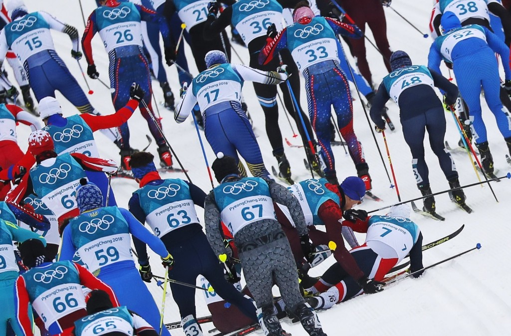 Andrey Larkov, an Olympic athlete from Russia, and Simen Hegstad Krueger of Norway crash during the men's skiathlon. REUTERS/Carlos Barria