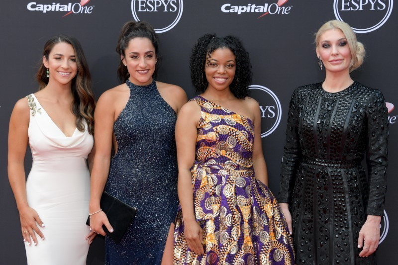 Scores of gymnasts who survived doctor's abuse unite at ESPYs