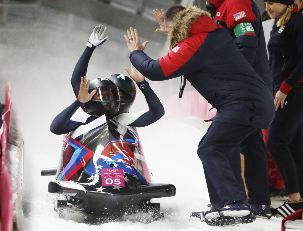 Elana Meyers Taylor and Lauren Gibbs of U.S. taking silver in women's bobsled. REUTERS/Edgar Su
