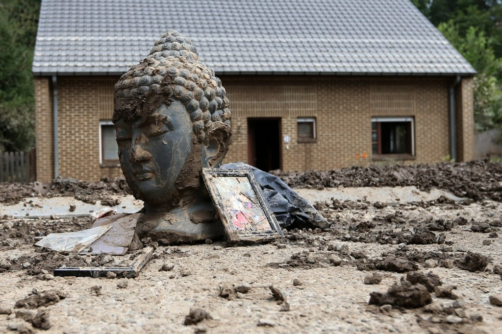 Statue of Buddha covered with mud after heavy rains hit Ittre, Belgium. REUTERS/Francois Lenoir
