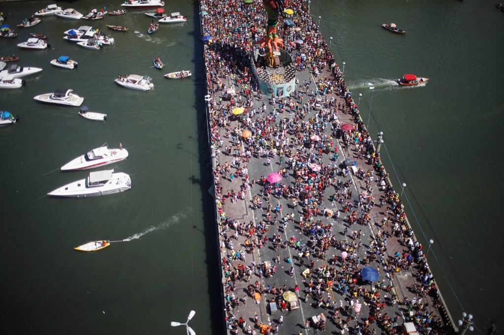 Revellers gather on a bridge during carnival celebrations in Recife. Mario Tama/Getty Images