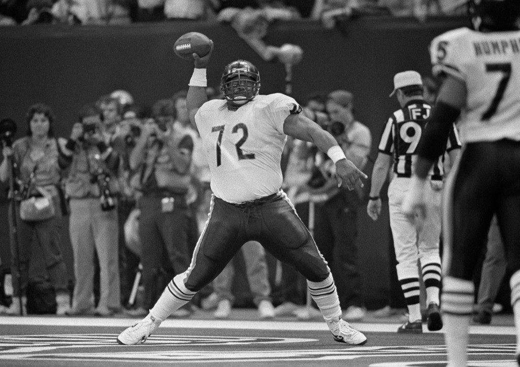 "Bears defensive lineman William ""Refrigerator"" Perry spikes the ball after scoring on a 1-yard run against the Patriots in Super Bowl XX in New Orleans, Jan. 1986. The Bears won, 46-10, in the first Super Bowl appearance for either team. AP Photo"
