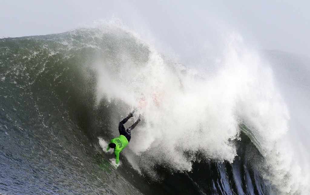 Ben Wilkinson goes tumbling into a wave during the third heat of the first round. AP Photo/Eric Risberg