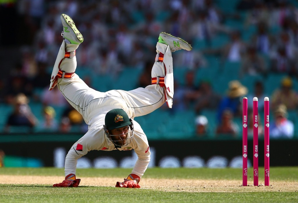 Australia's wicketkeeper Matthew Wade dives but fails to stop ball thrown at the wicket by teammate Nathan Lyon during match against Pakistan in Sydney. REUTERS/David Gray