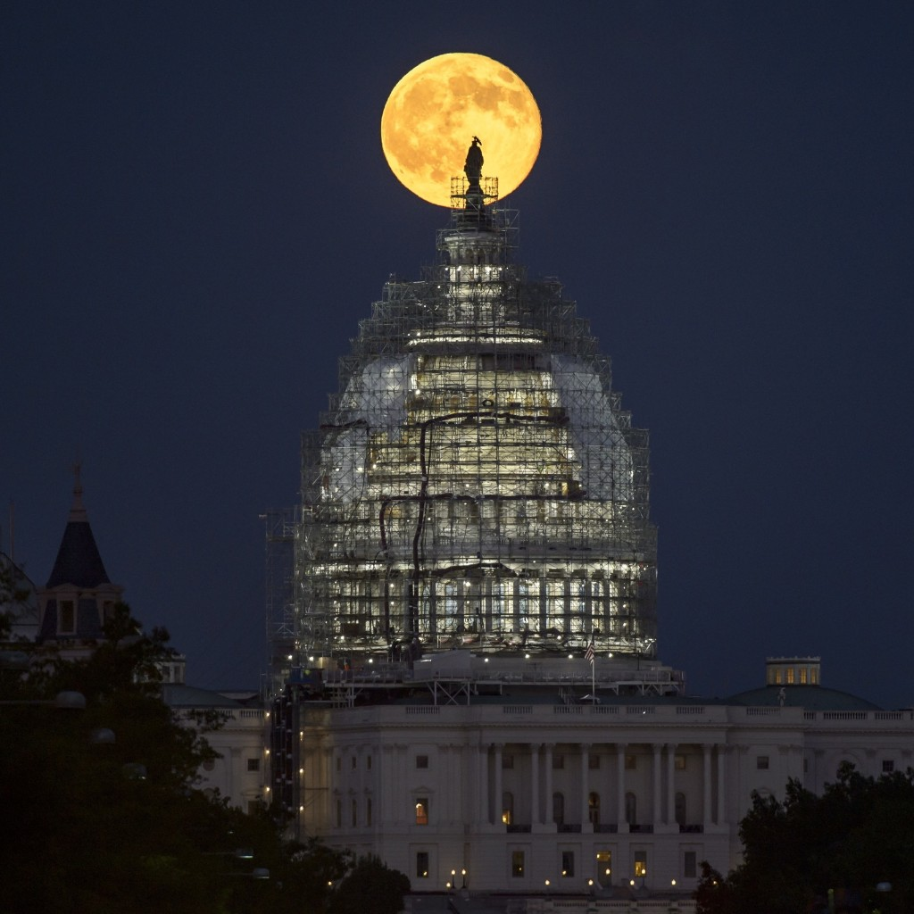 A second full moon for the month of July rises behind the dome of the U.S. Capitol. Bill Ingalls/NASA via Getty Images