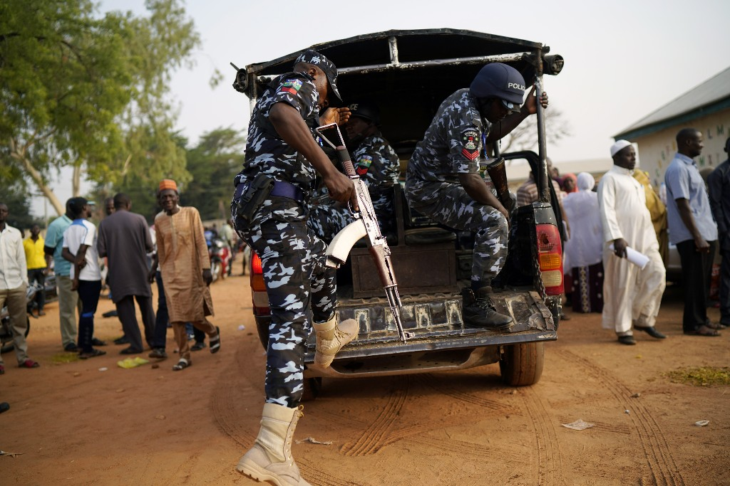 Nigerian police arrives at a polling station in Kaduna, Nigeria, Saturday, Feb. 23, 2019. Incumbent President Muhammadu Buhari is to face opposition presidential candidate Atiku Abubakarin in the presidential election. (AP Photo/Jerome Delay)
