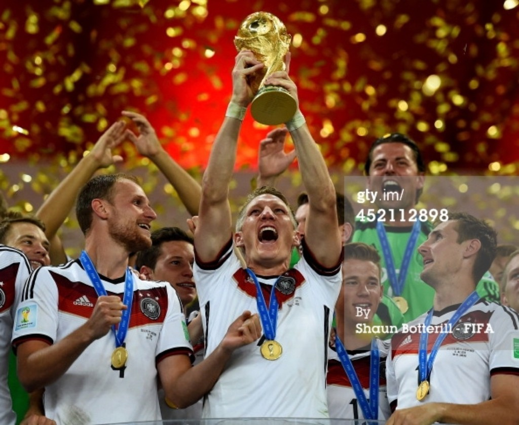 Bastian Schweinsteiger of Germany holds the World Cup aloft during the award ceremony. Shaun Botterill/FIFA/Getty Images