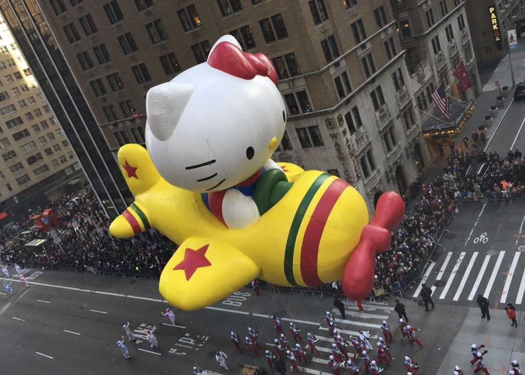 "The ""Hello Kitty"" balloon proceeds high above spectators along 6th Ave during the 89th Macy's Thanksgiving Day Parade in the Manhattan borough of New York Thursday. REUTERS/Carlo Allegri"