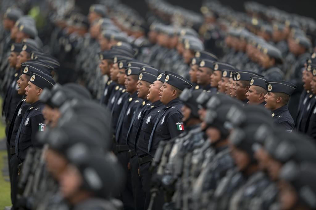 Officers belonging to Mexico's newest police force, known as the gendarmerie, take the service vow. AP Photo/Eduardo Verdugo