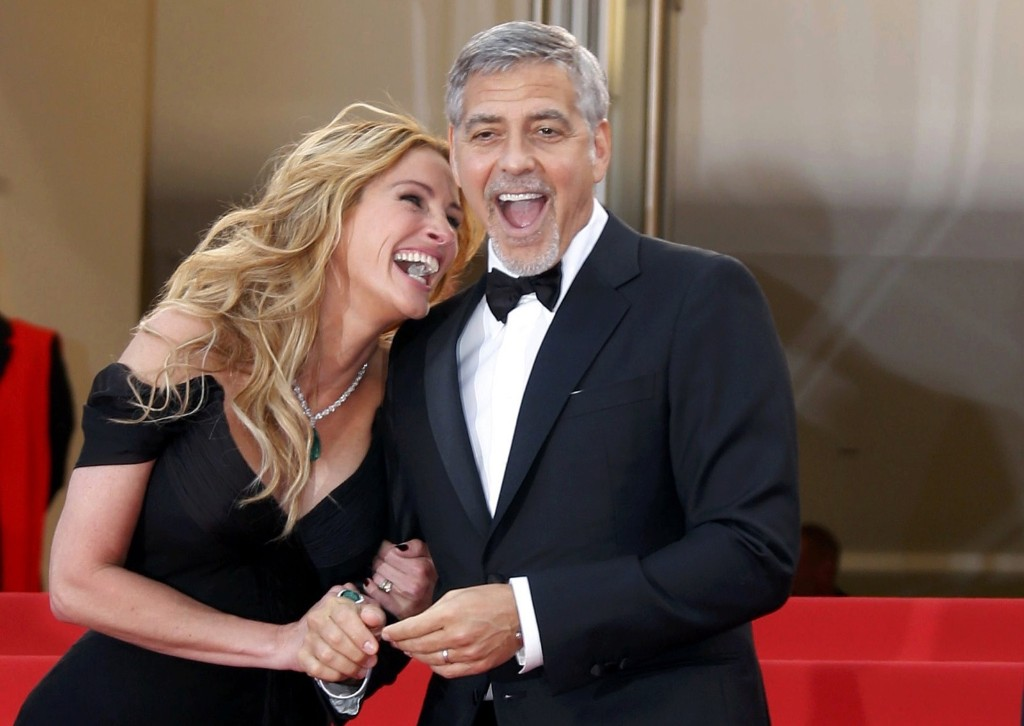 "Julia Roberts and George Clooney on the red carpet as they arrive for the screening of the film ""Money Monster"". REUTERS/Regis Duvignau"