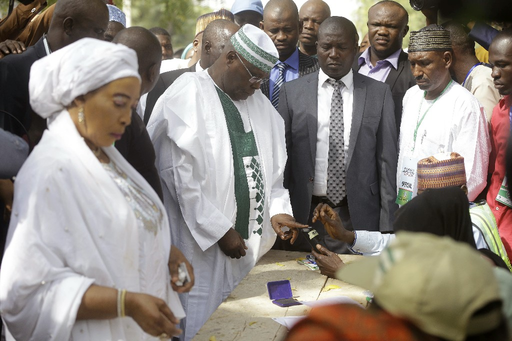 Opposition Presidential candidate Atiku Abubakar, center, before casting his vote at the Presidential and National Assembly election in Yola Nigeria, Saturday, Feb. 23, 2019. Incumbent President Muhammadu Buhari is to face opposition presidential candidate Atiku Abubakar in the presidential election. (AP Photo/Sunday Alamba)