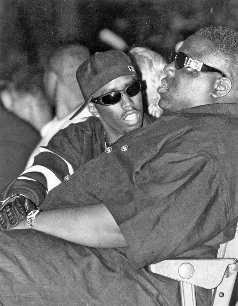 The Notorious B.I.G. and Puff Daddy take in Dr. Dre's performance at the Source Awards at the Palladium on August 3, 1995 in New York. Al Pereira/Michael Ochs Archives/Getty Images