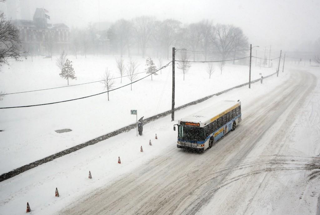 A lone city bus navigates South Limestone St. near the University of Kentucky in Lexington. AP Photo/James Crisp