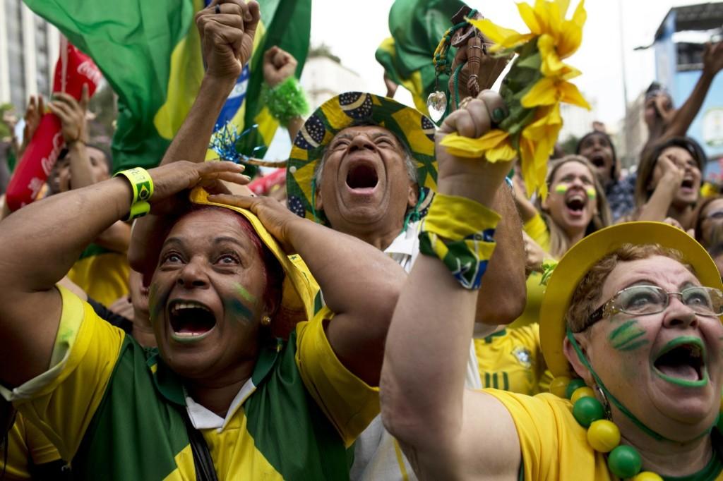 Brazil fans in Sao Paulo go crazy after their team scored a goal during penalty shootout. AP Photo/Rodrigo Abd