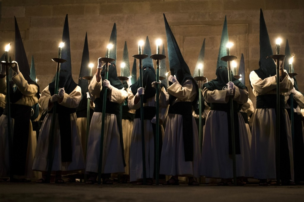 Penitents from 'Las Siete Palabras', take part in a procession in Zamora, Spain, during Easter Holy Week. AP Photo/Andres Kudacki