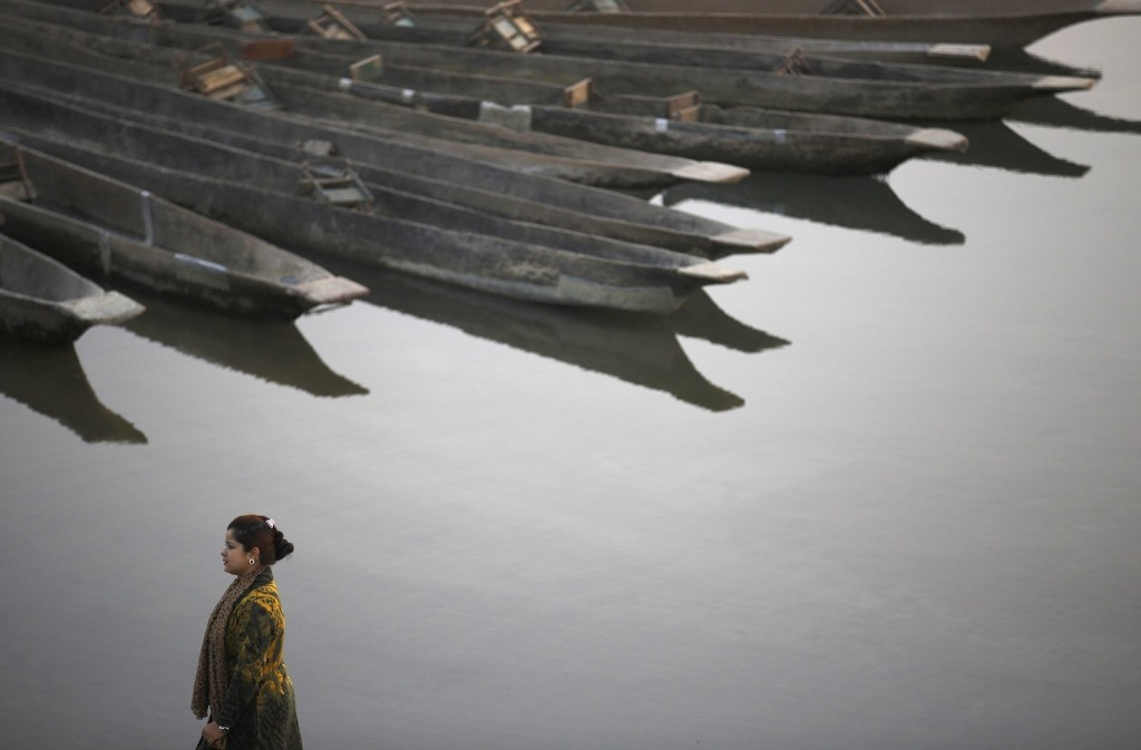A woman stands on the bank of Rapti River at Sauraha in Chitwan, south of Kathmandu. REUTERS/Navesh Chitrakar