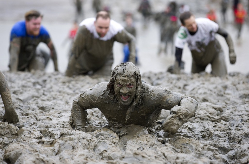 Participants crawl across the finish line during the annual Maldon Mud Race in England. JUSTIN TALLIS/AFP/Getty Images