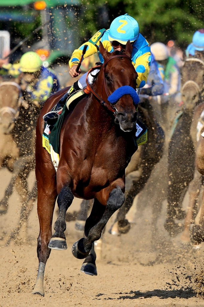 American Pharoah, ridden by Victor Espinoza, comes out of turn four during the 141st running of the Kentucky Derby, at Churchill Downs, Saturday, in Louisville. Andy Lyons/Getty Images