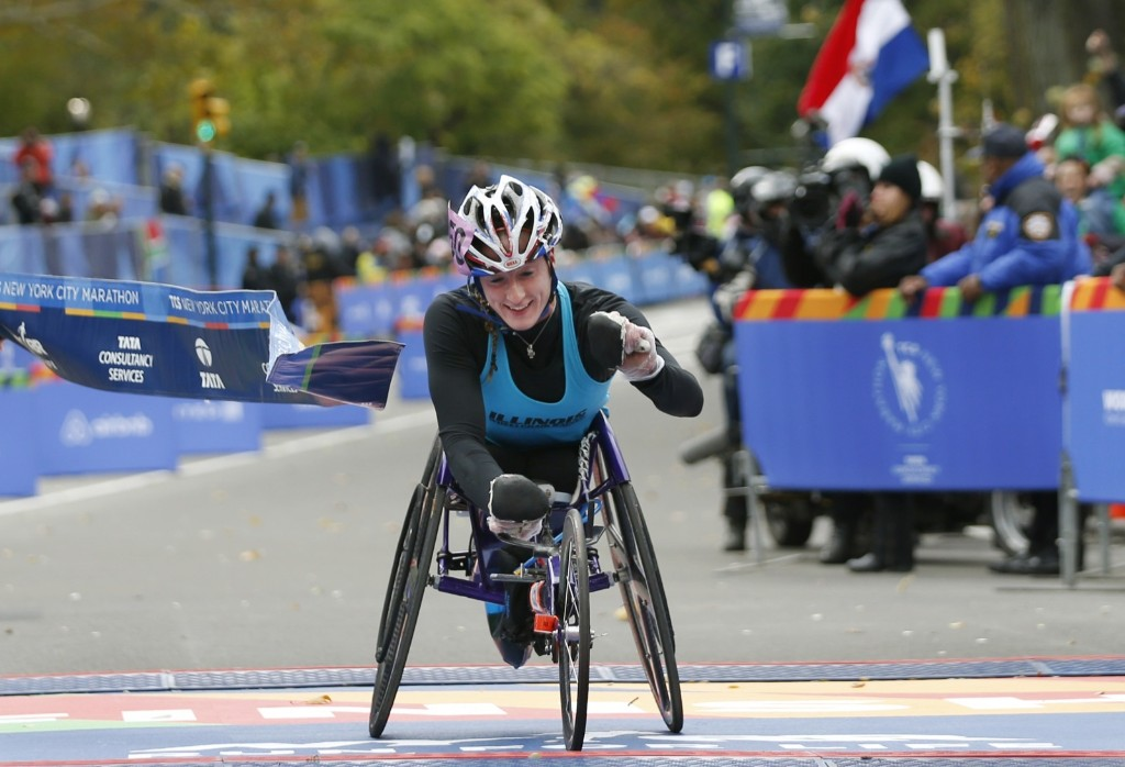Tatyana McFadden breaks the tape after finishing first in the womens wheelchair division. It was her 8th straight marathon victory over the past two years. AP Photo/Kathy Willens