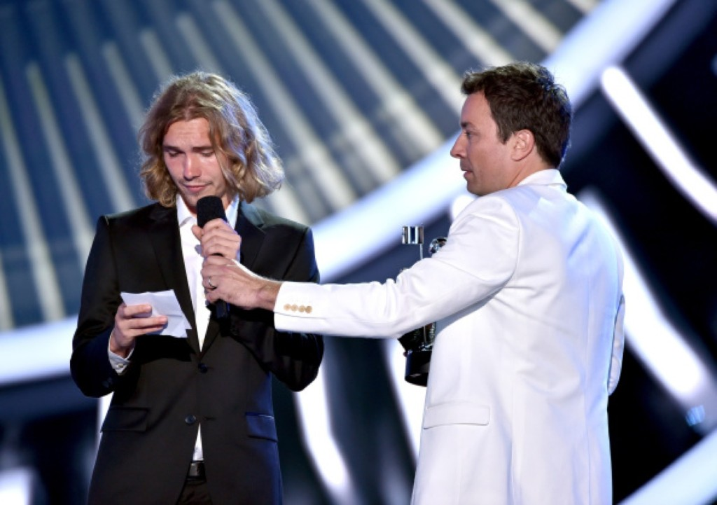 My Friend's Place representative Jesse accepts Video of the Year on behalf of Miley Cyrus for 'Wrecking Ball' from TV personality Jimmy Fallon. Photo by Kevin Winter/Getty Images for MTV