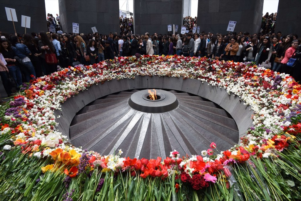 People lay flowers at the Tsitsernakaberd Armenian Genocide Memorial in Yerevan. KAREN MINASYAN/AFP/Getty Images