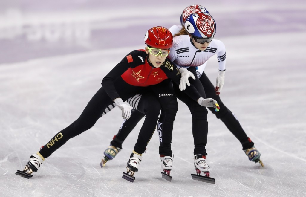 Minjeong Choi of Korea and Kexin Fan of China battle during the women's 3000m short track relay. XIN LI/Getty Images