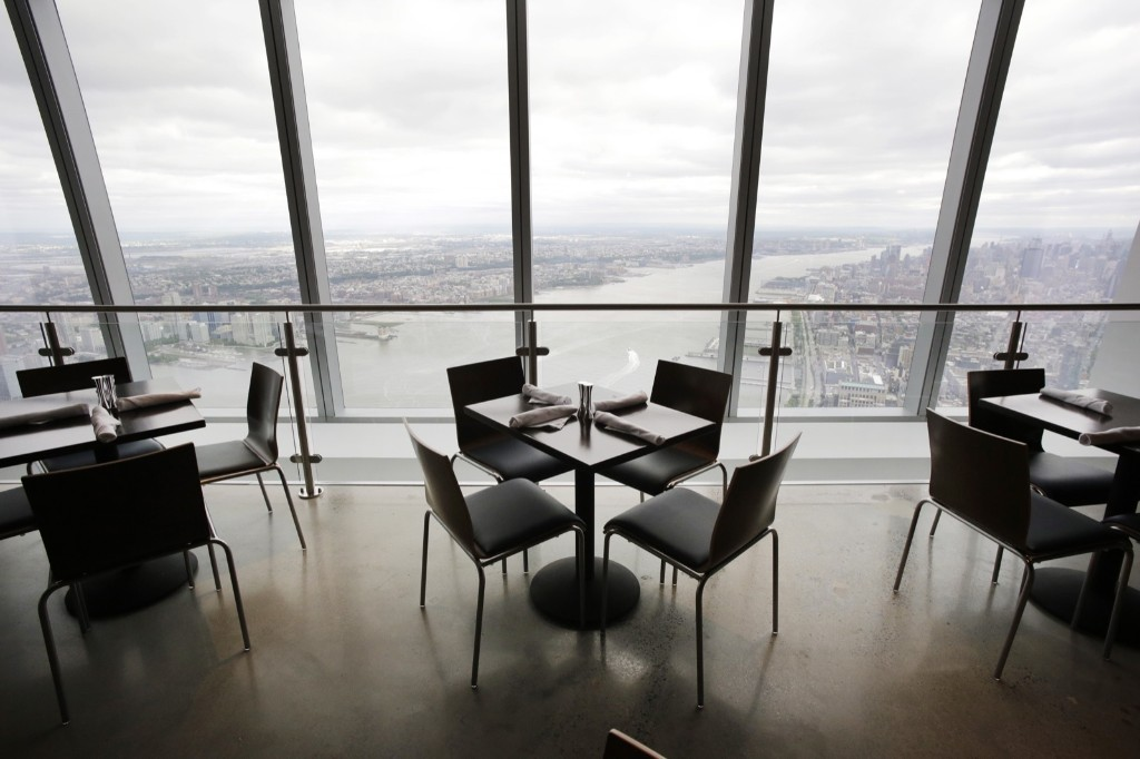 The dining area in One World Observatory has a view of the Hudson River, Wednesday, in New York. AP Photo/Mark Lennihan