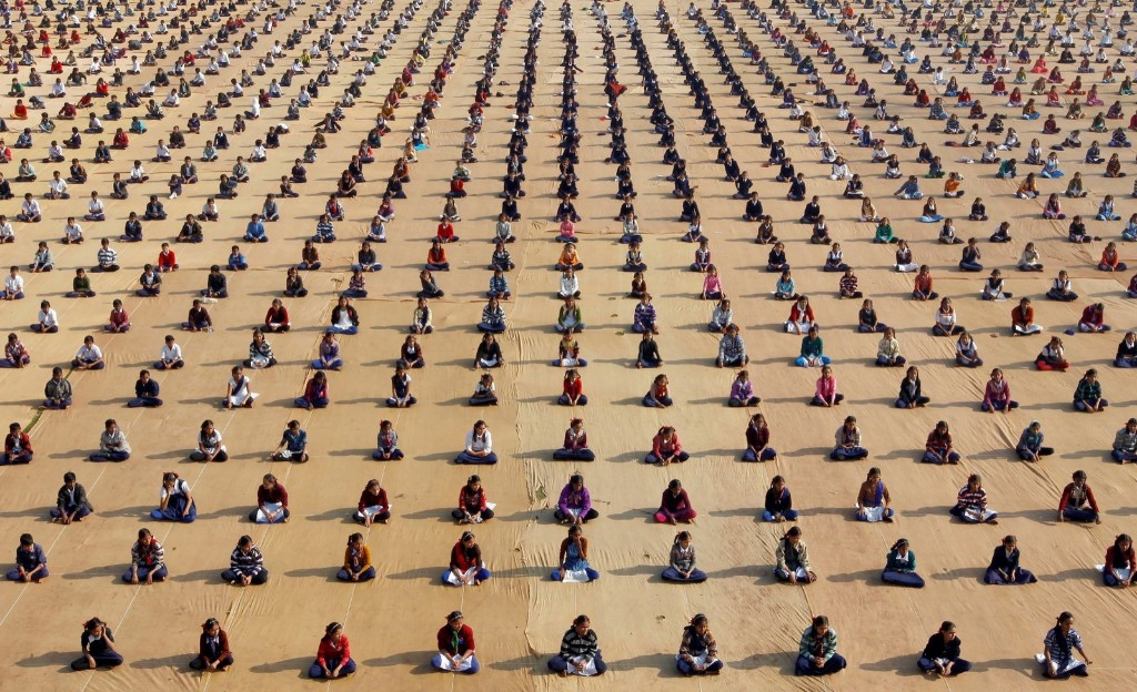 Schoolchildren attend a yoga session at a camp in Ahmedabad, India. REUTERS/Amit Dave