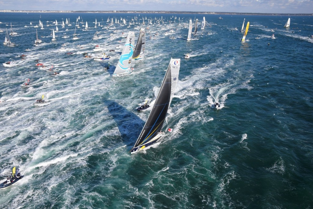 """French skipper Sebastien Josse on his class Imoca monohull """"Edmond de Rothschild"""" (foreground) at the start of the Vendee Globe around-the-world solo sailing race off the coast of Les Sables-d'Olonne, western France. DAMIEN MEYER/AFP/Getty Images"""