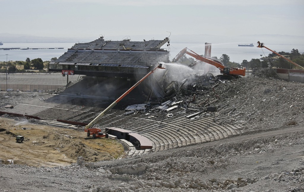 Crews work on the demolition of Candlestick Park in San Francisco. AP Photo/Eric Risberg