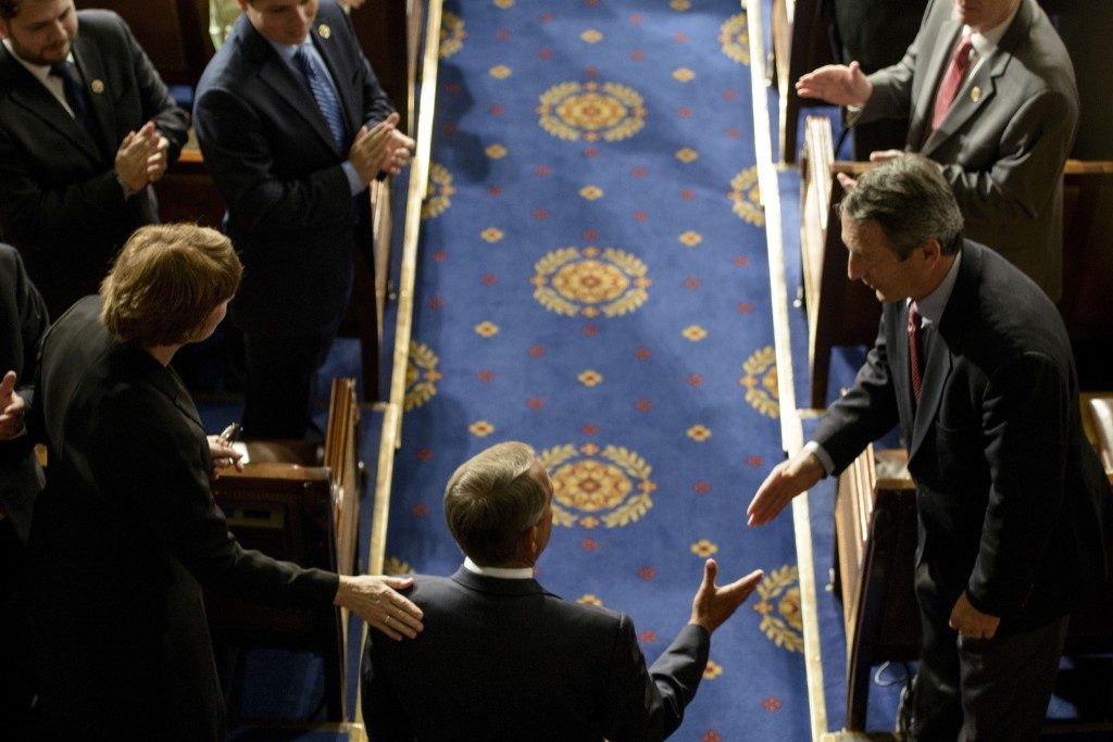 John Boehner enters the House chamber after being re-elected Speaker of the House. BRENDAN SMIALOWSKI/AFP/Getty Images