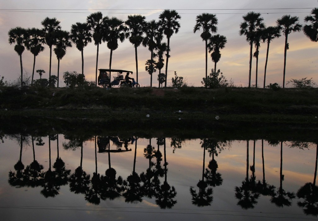 A motor-cart man takes his morning passengers from the outskirts to the main city of Phnom Penh, Cambodia. AP Photo/Heng Sinith