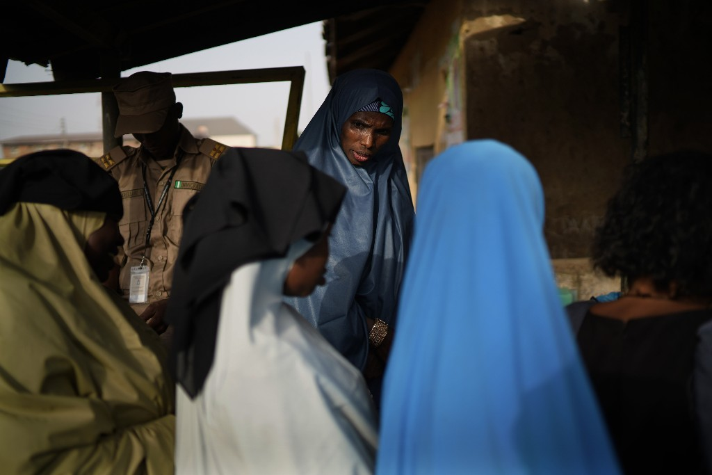 Women line up to cast their vote in Kaduna, Nigeria, Saturday, Feb. 23, 2019. Incumbent President Muhammadu Buhari is to face opposition presidential candidate Atiku Abubakar in the presidential election. (AP Photo/Jerome Delay)