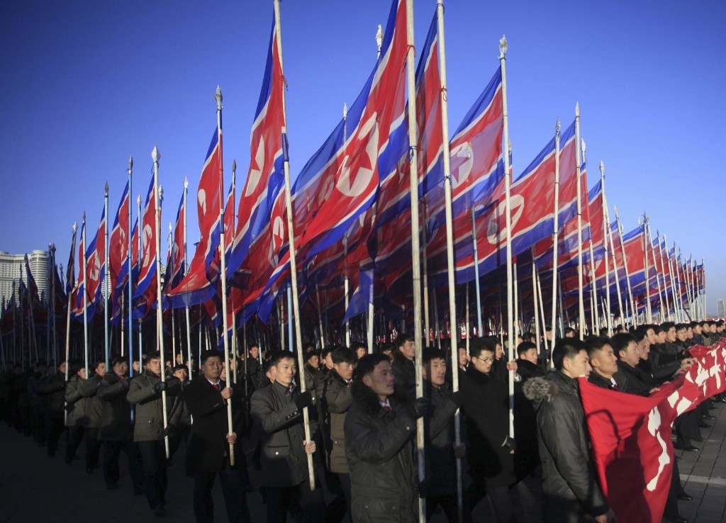 North Koreans parade in Kim Il Sung Square in Pyongyang to show their loyalty to the Workers' Party. AP Photo/Jon Chol Jin