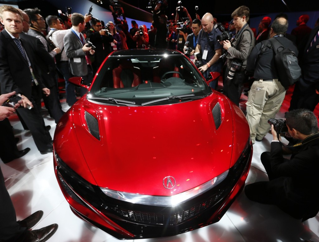 The Acura NSX at its debut during previews for the North American International Auto Show in Detroit, Monday. AP Photo/Paul Sancya