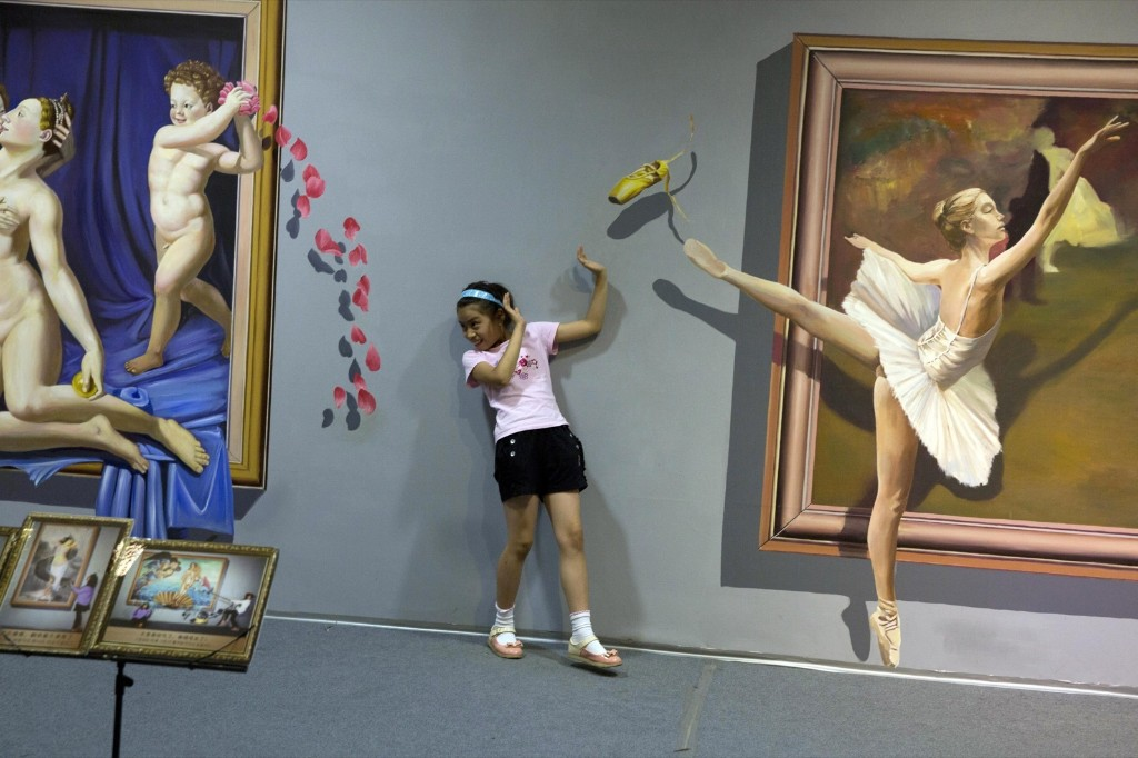 An art exhibit, which appears three-dimensional, in Beijing. AP Photo/Ng Han Guan